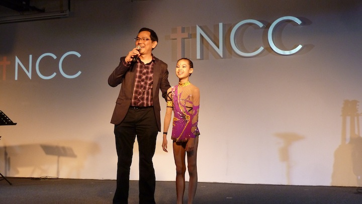 Chairman of the celebration Vincent Yap with gymnast Georgia